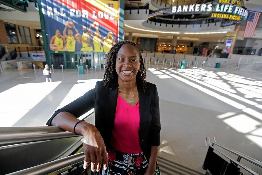 FILE - In this June 26, 2019 file photo, Tamika Catchings poses for a photo inside Banker's Life Fieldhouse in Indianapolis. Catchings is part of a nine-person group announced Saturday, April 4, 2020,  as this year's class of enshrinees into the Naismith Memorial Basketball Hall of Fame.