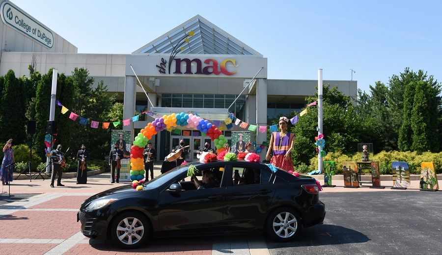The first car passes during a drive-by celebration in honor of what would have been Frida Kahlo's 113th birthday at the College of DuPage, which is hosting a major Kahlo art exhibit in 2021.