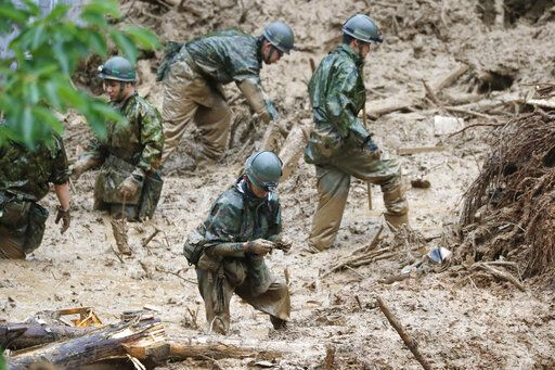 Japan Ground Self-Defense Force search missing persons at the site of a mudslide in Tsunagi town, Kumamoto prefecture, southwestern Japan, Tuesday, July 7, 2020. Floodwaters flowed down streets in southwestern Japanese towns hit by deadly rains that were expanding across the region Tuesday. (Kyodo News via AP)