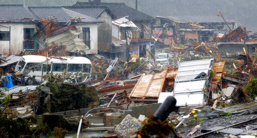 Debris is scattered at a residential area hit by heavy rain in Kumamura, Kumamoto prefecture, southern Japan Tuesday, July 7, 2020. Rescue operations continued and rain threatened wider areas of the main island of Kyushu. (Kota Endo/Kyodo News via AP)