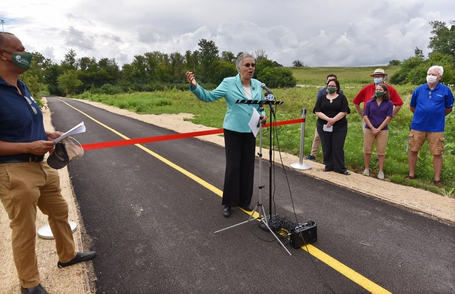 Cook County Board President Toni Preckwinkle speaks at the ceremony to officially open a new paved trail connecting Hoffman Estates neighborhoods to the Poplar Creek Trail system on Saturday near Bridlewood Drive and Shoe Factory Road.