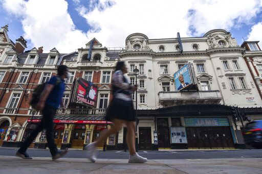 Theaters in the West End are closed due to the Coronavirus outbreak, in London, Saturday, Aug. 1, 2020. Prime Minister Boris Johnson put some planned measures to ease the U.K.'s lockdown on hold Friday, saying the number of new coronavirus cases in the country is on the rise for the first time since May. He called off plans to allow venues, including casinos, bowling alleys and skating rinks, to open from Saturday, Aug. 1.