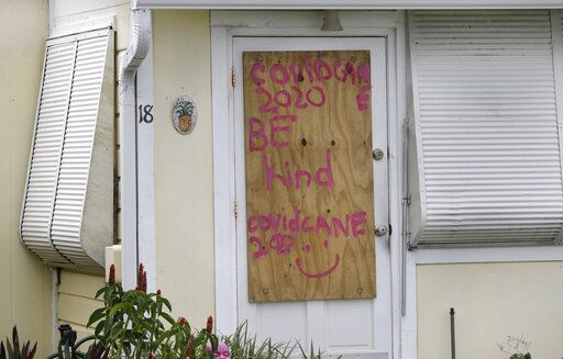 A boarded up home is shown, Saturday, Aug. 1, 2020, in Briny Breezes, Fla. Hurricane Isaias has snapped trees and knocked out power while blowing through the Bahamas on Saturday. It's headed toward the Florida coast, where officials have closed beaches, parks and coronavirus testing sites.