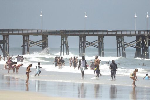 Daytona Beach, Fla., is crowded with beachgoers Saturday, Aug. 1, 2020. Isaias is expected to regain hurricane strength before reaching Florida. (Stephen M. Dowell/Orlando Sentinel via AP)