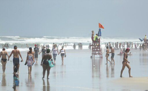 Daytona Beach, Fla., is crowded with beachgoers Saturday, Aug. 1, 2020. Isaias is expected to regain hurricane strength before reaching Florida.  Though officials do not expect to have to evacuate people, they wrestled with how to prepare shelters where people can seek refuge from the storm if necessary, while safely social distancing to prevent the spread of the coronavirus. (Stephen M. Dowell/Orlando Sentinel via AP)