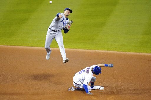 Tampa Bay Rays shortstop Willy Adames throws to first base after forcing out New York Mets' Jeff McNeil, below, during the fourth inning of a baseball game Monday, Sept. 21, 2020, in New York. New York Mets' Dominic Smith reached first base on the play.