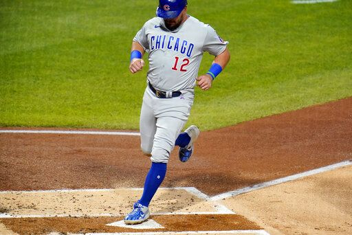 Chicago Cubs' Kyle Schwarber scores from third on a bunt single by Javier Baez during the second inning of a baseball game against the Pittsburgh Pirates in Pittsburgh, Monday, Sept. 21, 2020.