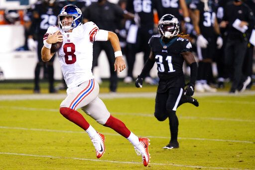 New York Giants' Daniel Jones runs with the ball during the second half of an NFL football game against the Philadelphia Eagles, Thursday, Oct. 22, 2020, in Philadelphia.