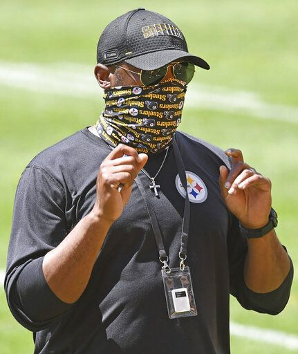 FILE - In this Aug. 17, 2020, file photo, Pittsburgh Steelers head coach Mike Tomlin looks on during practice at Heinz Field in Pittsburgh. On Sunday, Oct. 25, Steelers-Titans will be the eighth time in league history undefeated and untied teams with at least five wins have met in the regular season, the sixth such game since the 1970 merger, and only the fifth in the past 46 seasons. (Chaz Palla/Pittsburgh Tribune-Review via AP, File)