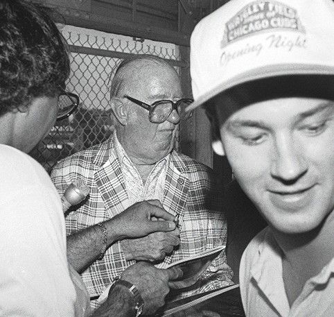 Cubs broadcaster Jack Brickhouse meets with fans during the first night game at Wrigley Field in Aug. 1988.