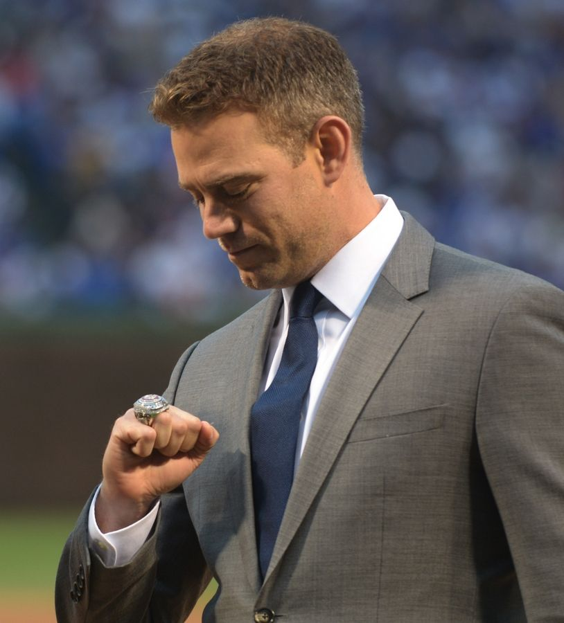 Theo Epstein checks out his World Series ring during an April 2017 ceremony at Wrigley Field.