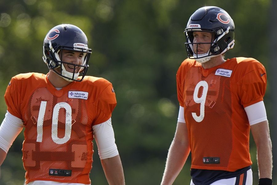 In this Aug. 17, 2020, file photo, Chicago Bears quarterbacks Mitchell Trubisky, left, and Nick Foles walk on the field during an NFL football camp practice in Lake Forest, Ill. The Bears acquired Super Bowl 52 MVP Foles to compete with former No. 2 draft pick Trubisky for the starting quarterback job, one of several moves to shake up an offense that ranked among the NFL's worst last season.