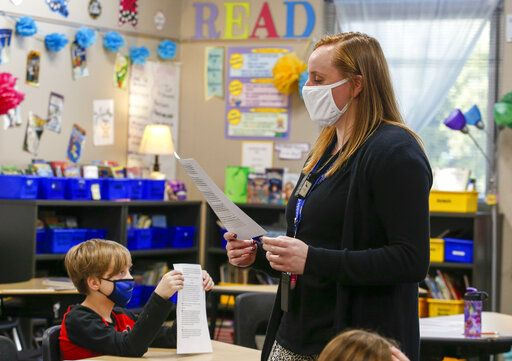 Lincoln-Douglas teacher Hannah Marks leads her class in an article about the Inuit at Lincoln-Douglas Elementary school in Quincy, Ill., Wednesday, Nov. 4, 2020. (Jake Shane/Quincy Herald-Whig via AP)