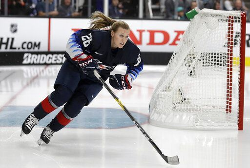 FILE - In this Jan. 25, 2019, file photo, United States' Kendall Coyne Schofield skates during the Skills Competition, part of the NHL All-Star weekend, in San Jose, Calif. The Chicago Blackhawks on Monday, Nov. 23, 2020, hired Kendall Coyne Schofield as player development coach. She's the first woman to hold that job in the organization's history. The former U.S. women's national team player will additionally serve as the team's youth hockey growth specialist.
