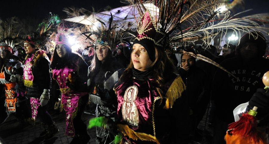 Dancers in colorful costumes joined thousands of worshippers who made the annual pilgrimage to Des Plaines last year for the Feast of Our Lady of Guadalupe. This year's celebration has been canceled due to the pandemic, church leaders announced Tuesday.