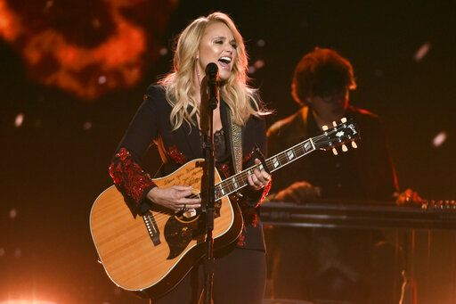 "FILE - In this April 15, 2018, file photo, Miranda Lambert performs ""Keeper of the Flame"" at the 53rd annual Academy of Country Music Awards in Las Vegas. Lambert was nominated for a Grammy for best country album. Other nominees in that category include Brandy Clark, Ashley McBryde and Ingrid Andress. (Photo by Chris Pizzello/Invision/AP, File)"