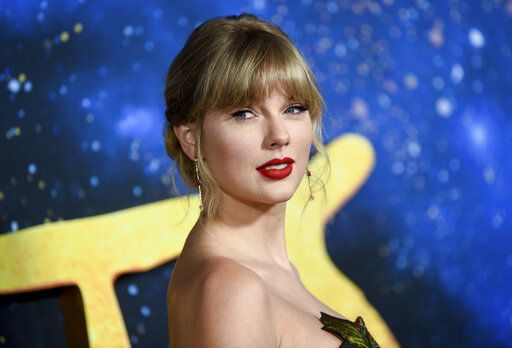 "FILE - Singer-actress Taylor Swift attends the world premiere of ""Cats"" in New York on Dec. 16, 2019. A concert film featuring Taylor Swift performing songs from her new album is coming to Disney+. The singer announced Tuesday that 'œfolklore: the long pond studio sessions'� will premiere on the streaming platform on Wednesday.  (Photo by Evan Agostini/Invision/AP, File)"