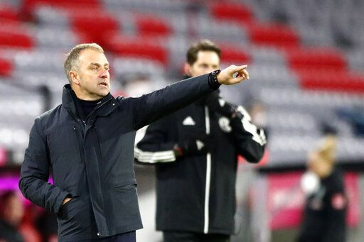 Bayern's head coach Hans-Dieter Flick gives instructions to his players during the German Bundesliga soccer match between FC Bayern Munich and SV Werder Bremen in Munich, Germany, Saturday, Nov. 21, 2020.