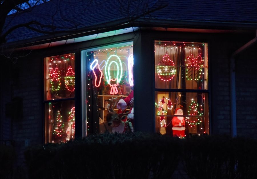Holiday lights are contained to the corner window on a home Tuesday on Forest Avenue in Palatine.