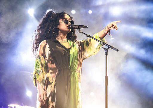 FILE - This April 14, 2019 file photo shows H.E.R. performing at the Coachella Music & Arts Festival in Indio, Calif. H.E.R. will perform during the 'œIn Memoriam'� segment at the Emmy Awards on Sunday. (Photo by Amy Harris/Invision/AP, File)