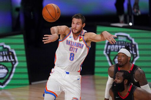 Oklahoma City Thunder's Danilo Gallinari (8) passes the ball as Houston Rockets' James Harden, bottom right, and Robert Covington, right rear, look on during the second half of an NBA first-round playoff basketball game in Lake Buena Vista, Fla., Wednesday, Sept. 2, 2020.