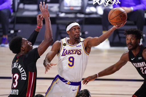 Los Angeles Lakers' Rajon Rondo (9) goes up for a shot against Miami Heat's Bam Adebayo (13) during the first half in Game 6 of basketball's NBA Finals Sunday, Oct. 11, 2020, in Lake Buena Vista, Fla.