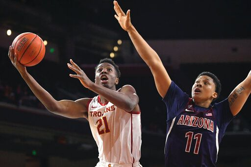 FILE - In this Thursday, Feb. 27, 2020, file photo, Southern California forward Onyeka Okongwu, left, shoots as Arizona forward Ira Lee defends during the first half of an NCAA college basketball game in Los Angeles. Okongwu was selected by the Atlanta Hawks in the NBA draft Wednesday, Nov. 18, 2020.
