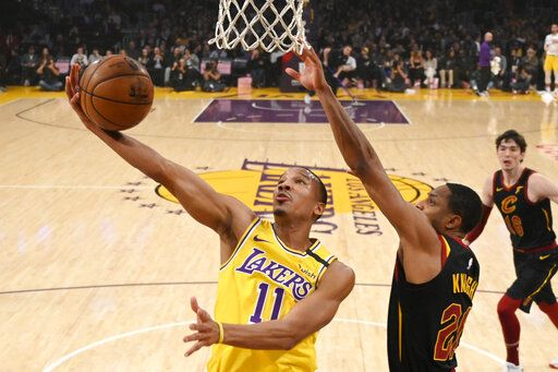 FILE - In this Jan. 13, 2020, file photo, Los Angeles Lakers guard Avery Bradley, left, shoots as Cleveland Cavaliers guard Brandon Knight defends during the first half of an NBA basketball game in Los Angeles. Bradley still has serious concerns about the coronavirus, particularly because one of his children has struggled with respiratory illnesses. Those concerns kept him from the NBA's restart bubble. They won't keep him from this season. Bradley has finalized his new contract with the Miami Heat and says he will be ready to go when camp starts next week.