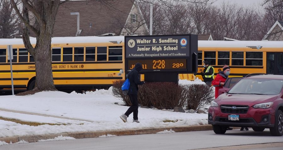 Students leave Walter R. Sundling Jr. High School in Palatine on Monday afternoon. Palatine Township Elementary District 15 returned to hybrid learning last week.
