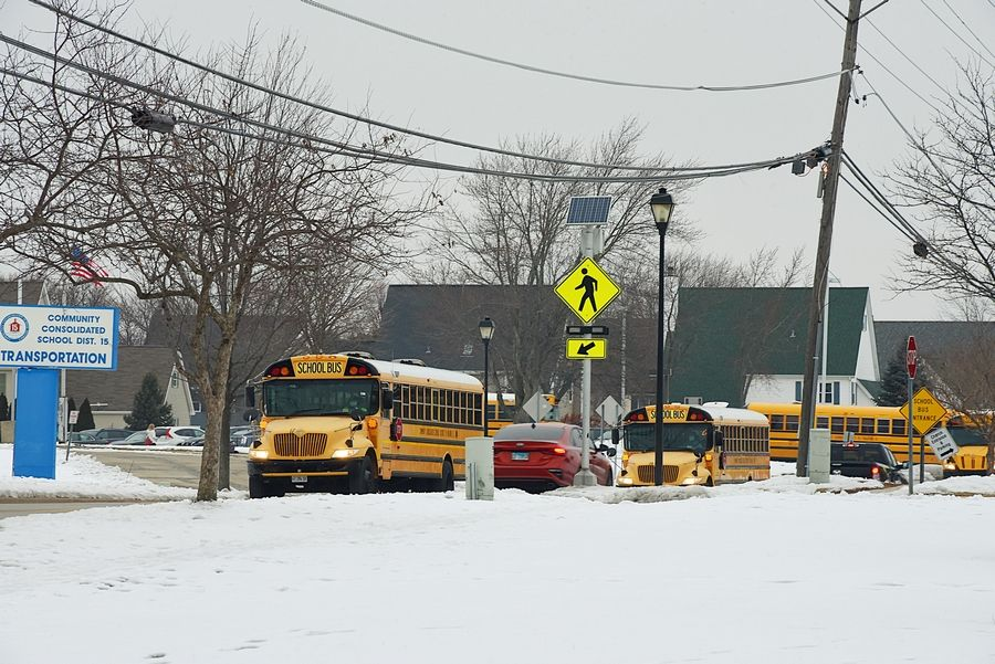 Palatine Township Elementary District 15 is back to hybrid learning as of last week after going all-virtual from Thanksgiving through the winter break. Pictured here are school buses on their way to pick up students at the end of the day Monday.