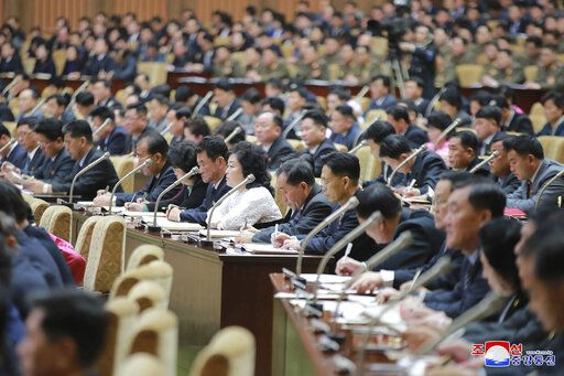 "In this photo provided by the North Korean government, members of the Supreme People's Assembly attend a meeting in Pyongyang, North Korea Sunday, Jan. 17, 2021. North Korea's rubber-stamp parliament has passed decisions made by a major ruling party meeting where leader Kim Jong Un vowed to bolster his nuclear deterrent and established plans to salvage a dismal economy. Independent journalists were not given access to cover the event depicted in this image distributed by the North Korean government. The content of this image is as provided and cannot be independently verified. Korean language watermark on image as provided by source reads: ""KCNA"" which is the abbreviation for Korean Central News Agency. (Korean Central News Agency/Korea News Service via AP)"