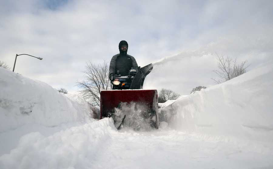 "Brian Kotowski, of Palatine uses his snowblower to dig out from an overnight snowstorm that once again hit the suburbs, ""The first couple of times were all right, now I don't like it,"" Kotowski mentioned as he took a break during his snow removal duties on Tuesday morning."