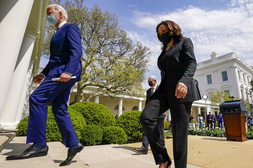 President Joe Biden, accompanied by Vice President Kamala Harris, right, and Attorney General Merrick Garland, second from right, departs after speaking about gun violence prevention in the Rose Garden at the White House, Thursday, April 8, 2021, in Washington.