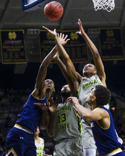 Notre Dame's Juwan Durham, left, and Prentiss Hubb, right, fight for a rebound with Chicago State's Christian Jacob (13) and Delshon Strickland during an NCAA college basketball game Thursday, Nov. 8, 2018, in South Bend, Ind. (Michael Caterina/South Bend Tribune via AP)